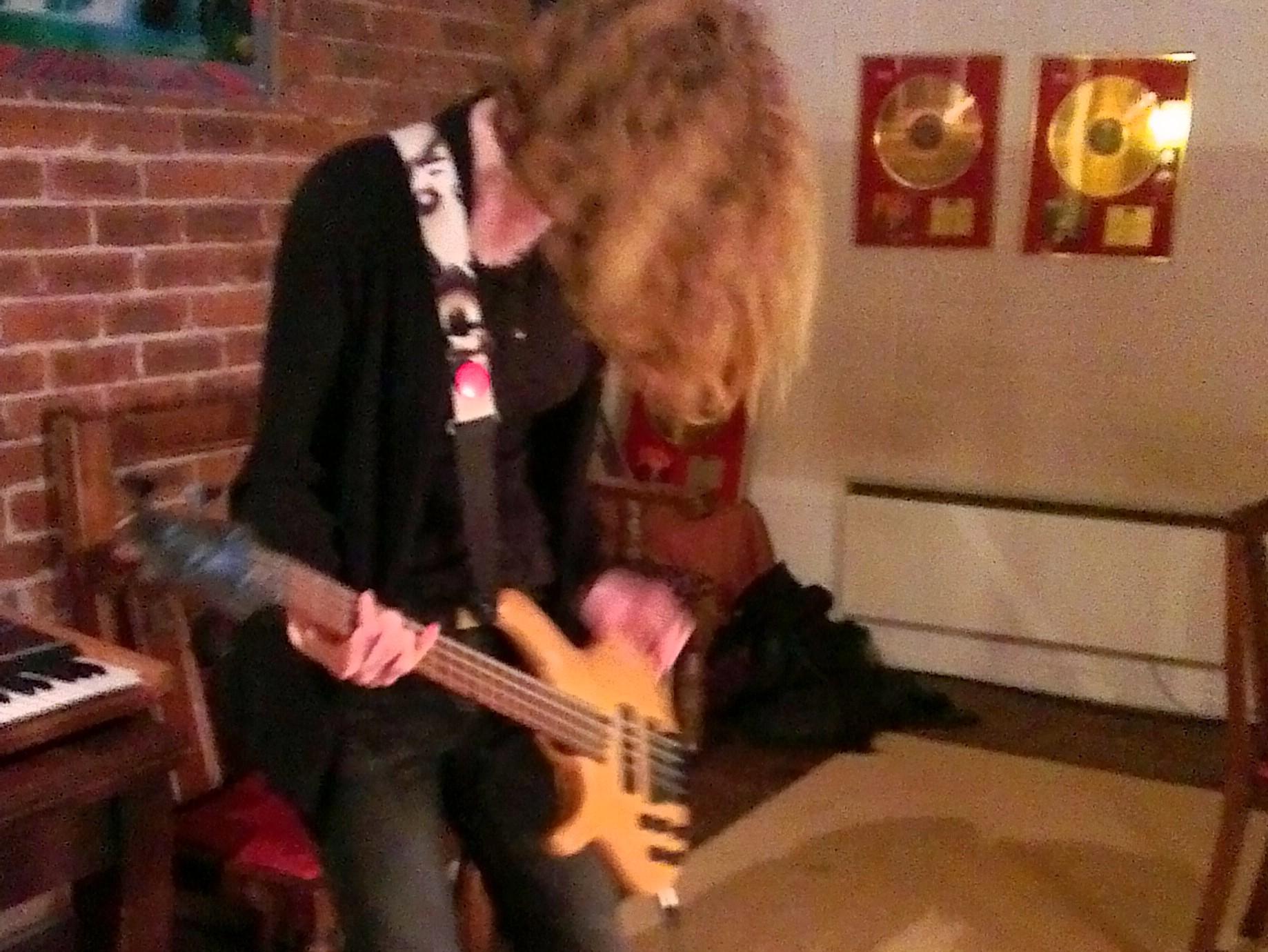 Faye playing bass